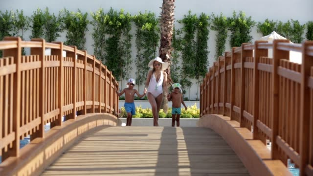 Mother and boys have fun in tourist resort hotel video