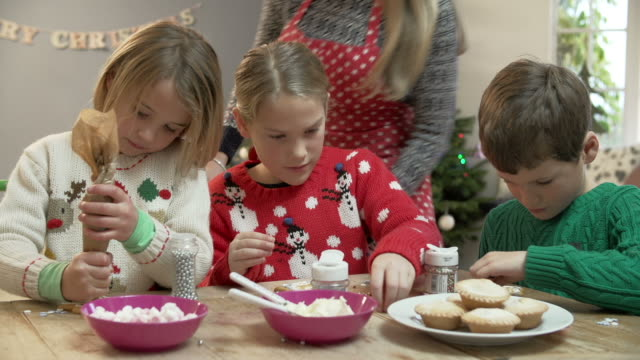 Mother And Children Decorating Christmas Cookies Together video