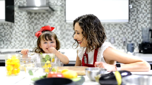 Mother and daughter cooking Mother and daughter preparing a healthy smoothie nutritionist stock videos & royalty-free footage