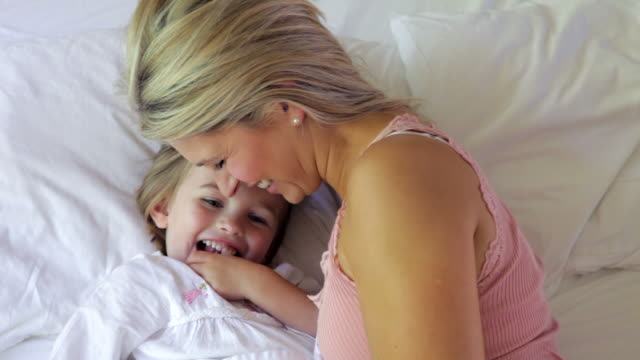 Mother And Daughter Cuddling In Bed video