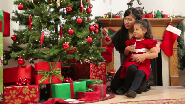 Mother and daughter decorate Christmas tree video