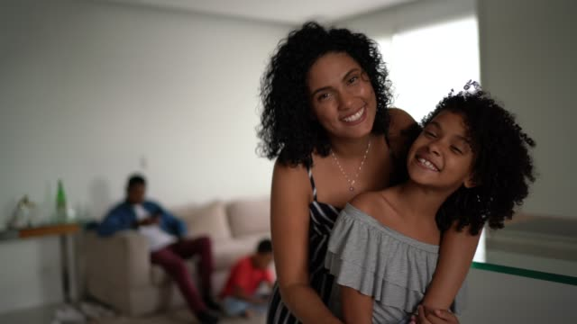 mother and daughter embracing at home - portrait - cultura latino americana video stock e b–roll