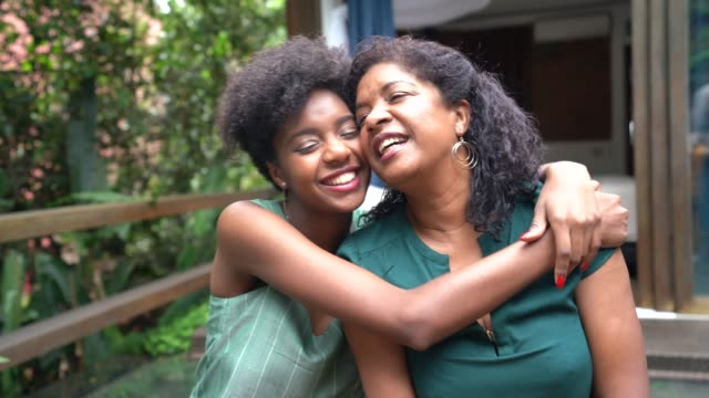 Mother and Daughter Embracing at Home BBQ Party hug stock videos & royalty-free footage