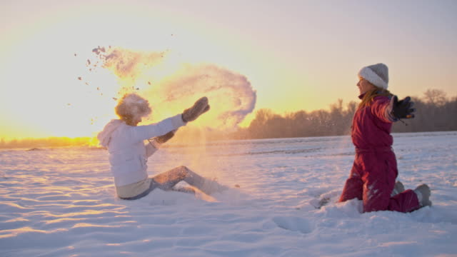 SLO MO Mother And Daughter Having Fun In Snow video