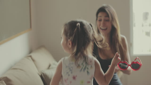 Mother and daughter having fun together at home video