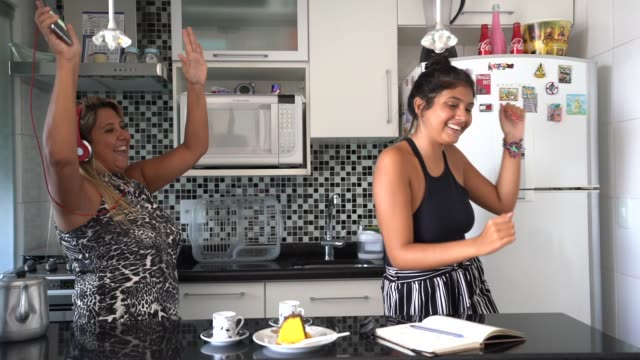 Mother and daughter having fun together while dancing in the kitchen Home lifestyle mothers day stock videos & royalty-free footage