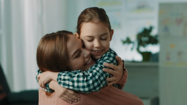 Mother and daughter hugging Mother huuging daughter at home hug stock videos & royalty-free footage