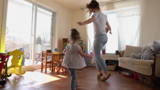 mother and daughter playing at home - 2 3 anni video stock e b–roll