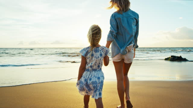 Mother and Daughter Playing at the Beach video