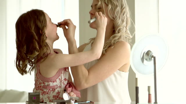 SLOW MOTION - Mother and daughter Putting On Make Up video