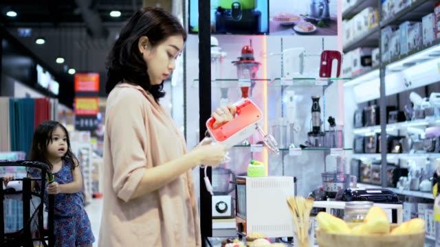 Mother and daughter Shopping in Electronics Store Asia Mother and daughter Shopping in Electronics Store electronics store stock videos & royalty-free footage