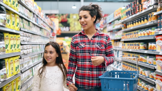 mother and daughter shopping in supermarket - parenting stock videos & royalty-free footage