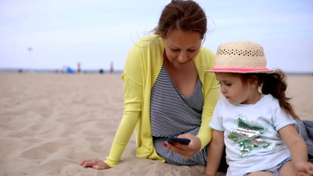 Mother and daughter spending time together on a beach