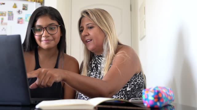 mother and daughter using laptop at home - teenagers stock videos & royalty-free footage
