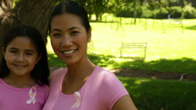 mother and daughter wearing pink for breast cancer awareness - breast cancer awareness 個影片檔及 b 捲影像