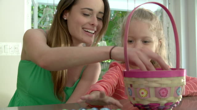 Mother And Daughter With Chocolate Easter Eggs And Basket video