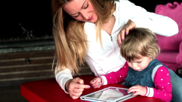 Mother and Daughter with digital tablet video