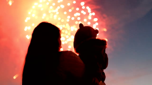 mother and her child watching fireworks. - independence day stock videos & royalty-free footage