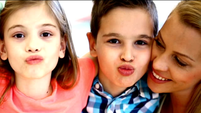Mother and kids being silly. video