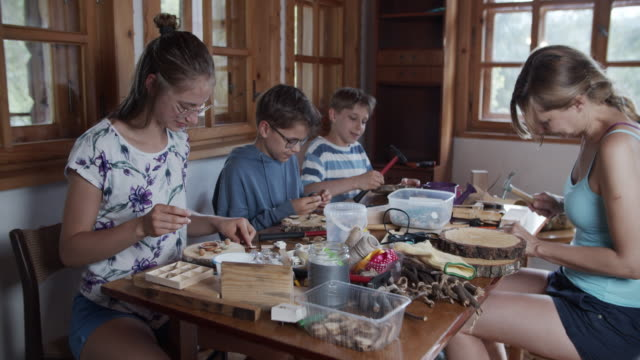 Mother and kids enjoying crafting and carpentry