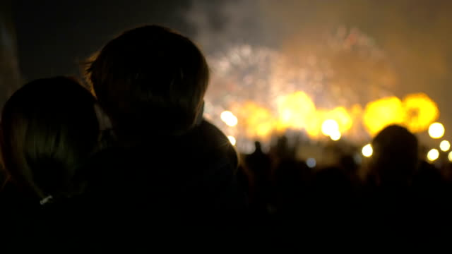 Mother and little son watching fireworks video