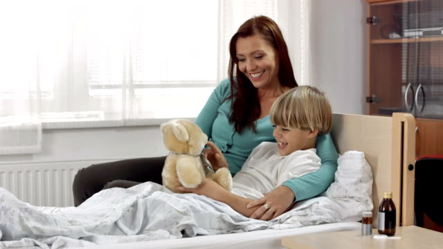 HD: Mother And Sick Son Playing With Teddy video