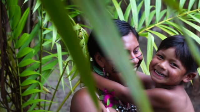 Mother and Son at an indigenous tribe in the Amazon video