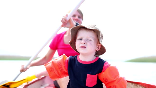 Mother and son having fun on a paddle boat video