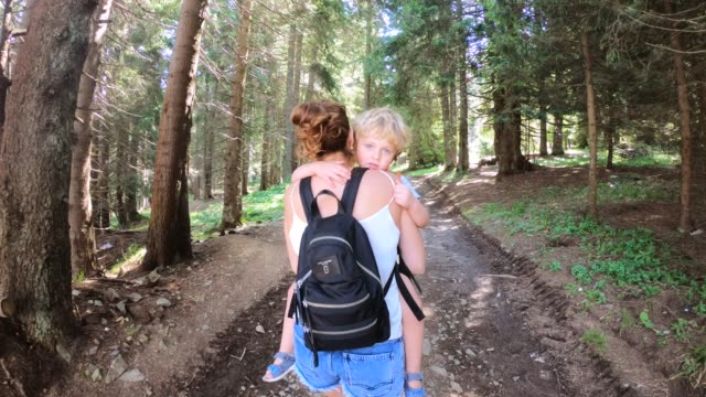 Mother and son hiking in forest