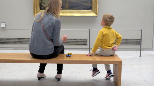Mother and son in art gallery video