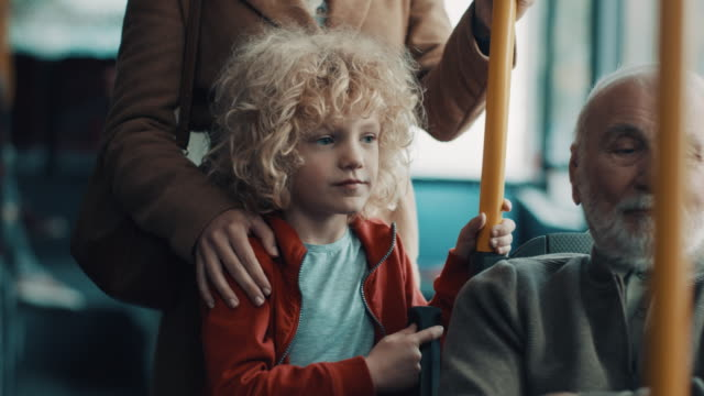 Mother and son in the bus video