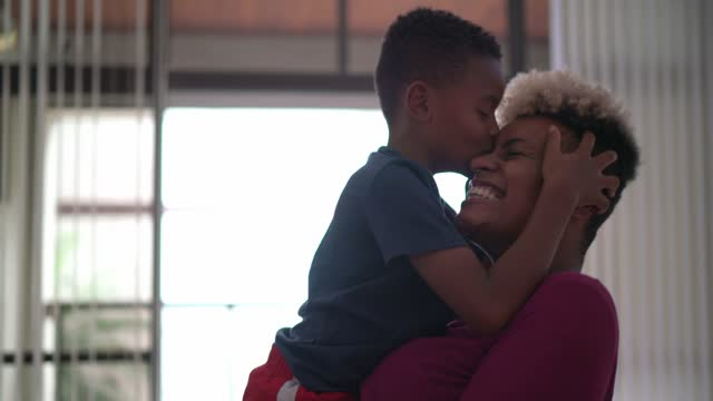 Mother and son on a love moment at home video
