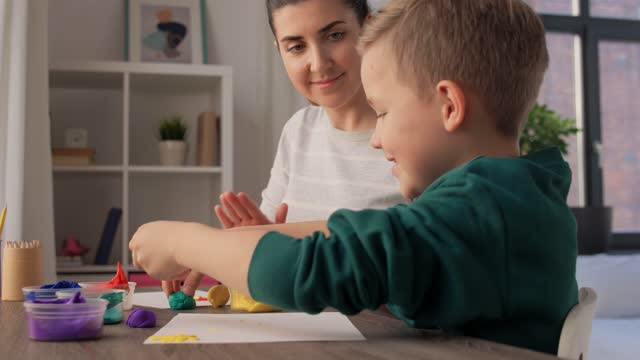 mother and son playing modeling clay at home