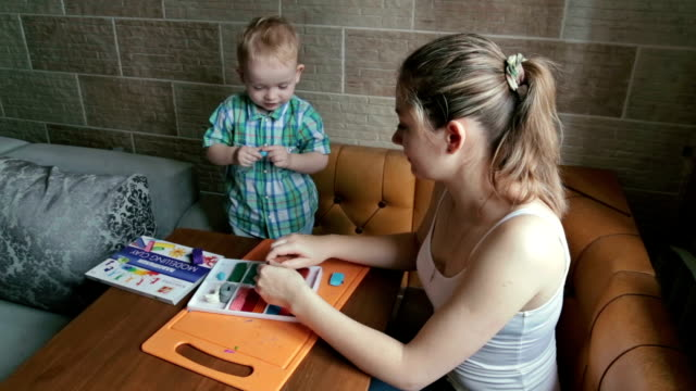 Mother and son playing with plasticine video
