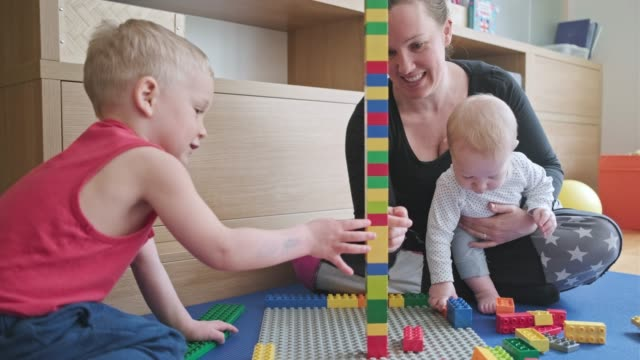 Mother and son playing with toy blocks