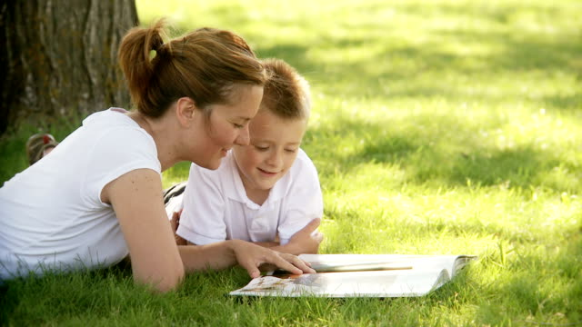 Mother and son read together video