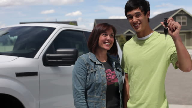 Mother and son, teen holds up keys to truck  car key stock videos & royalty-free footage