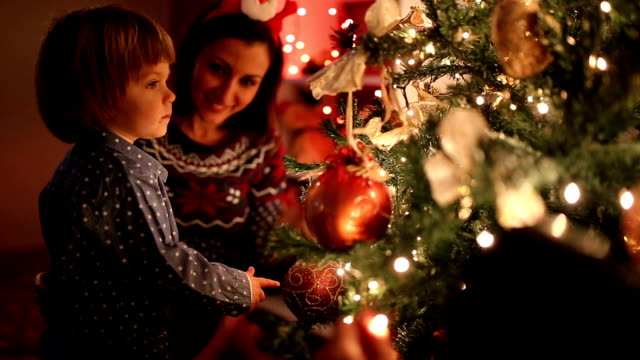 Mother and Son Waiting for Santa by Christmas Tree video