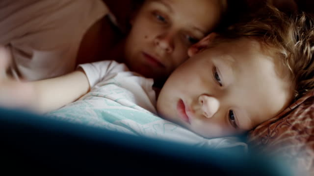 Mother and son with pad before bedtime video