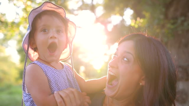 mother and suprise baby having fun. - sorpresa video stock e b–roll