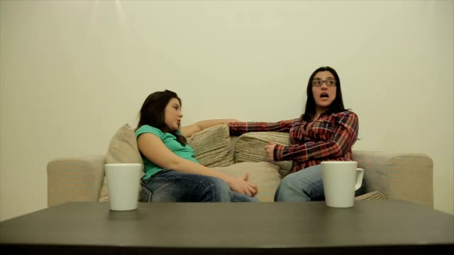 Mother and teenage daughter drink tea and talk,dolly shoot video
