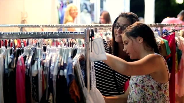 Mother and teenage daughter on shopping on summer vacation