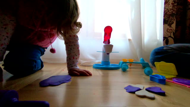 mother and two daughters playing with plasticine - mika video stock e b–roll