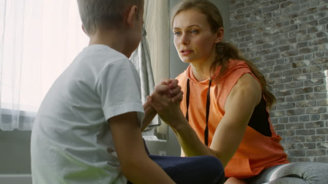 Mother Arm Wrestling with Little Son video