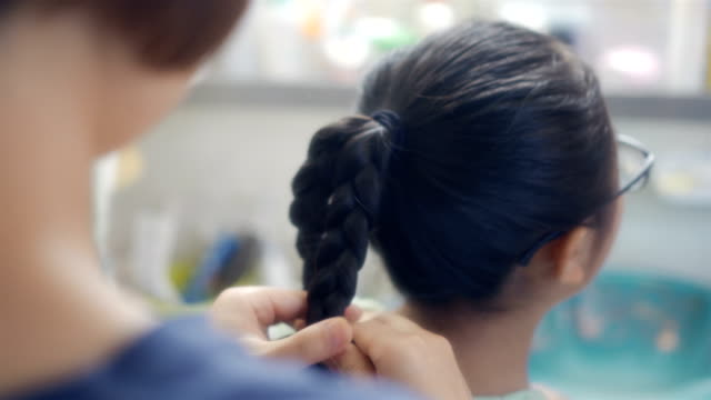 Mother braided her daughter Mother braided her daughter ponytail stock videos & royalty-free footage