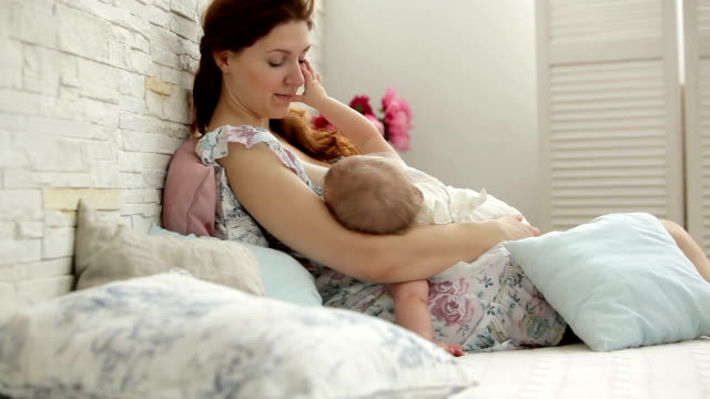 Mother breastfeeding a baby girl video