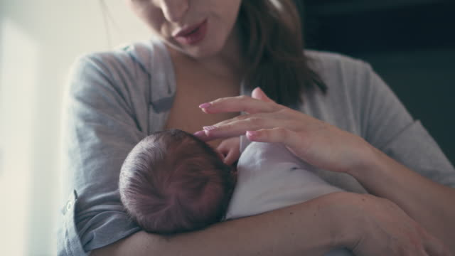 Mother breastfeeding her little baby girl video