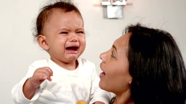 Mother carrying her baby crying video