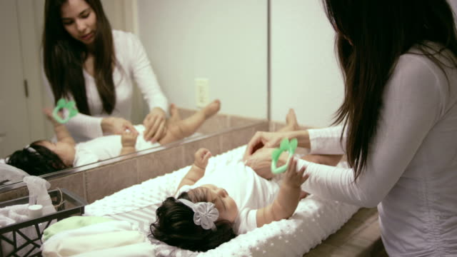 Mother changing babies diaper video