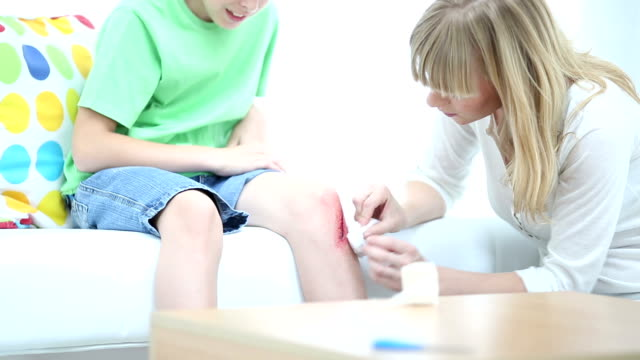 HD: Mother Cleaning sons scraped knee. video